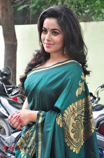 Actress Poorna Latest Pictures in Green Saree at SR Fashion Studio Launch  0003.jpg