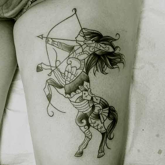 Amazing Sagittarius zodiac tattoo design on thigh