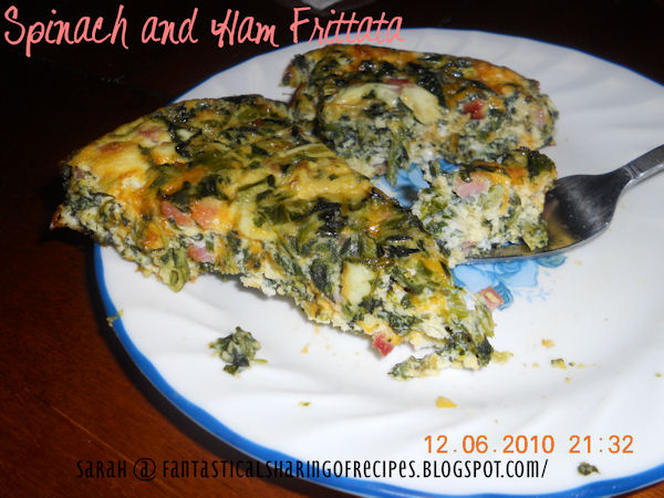 Spinach and Ham Frittata // This breakfast egg bake is chock full of leafy green spinach plus ham and cheddar! #recipe #breakfast #eggs #spinach #ham #frittata