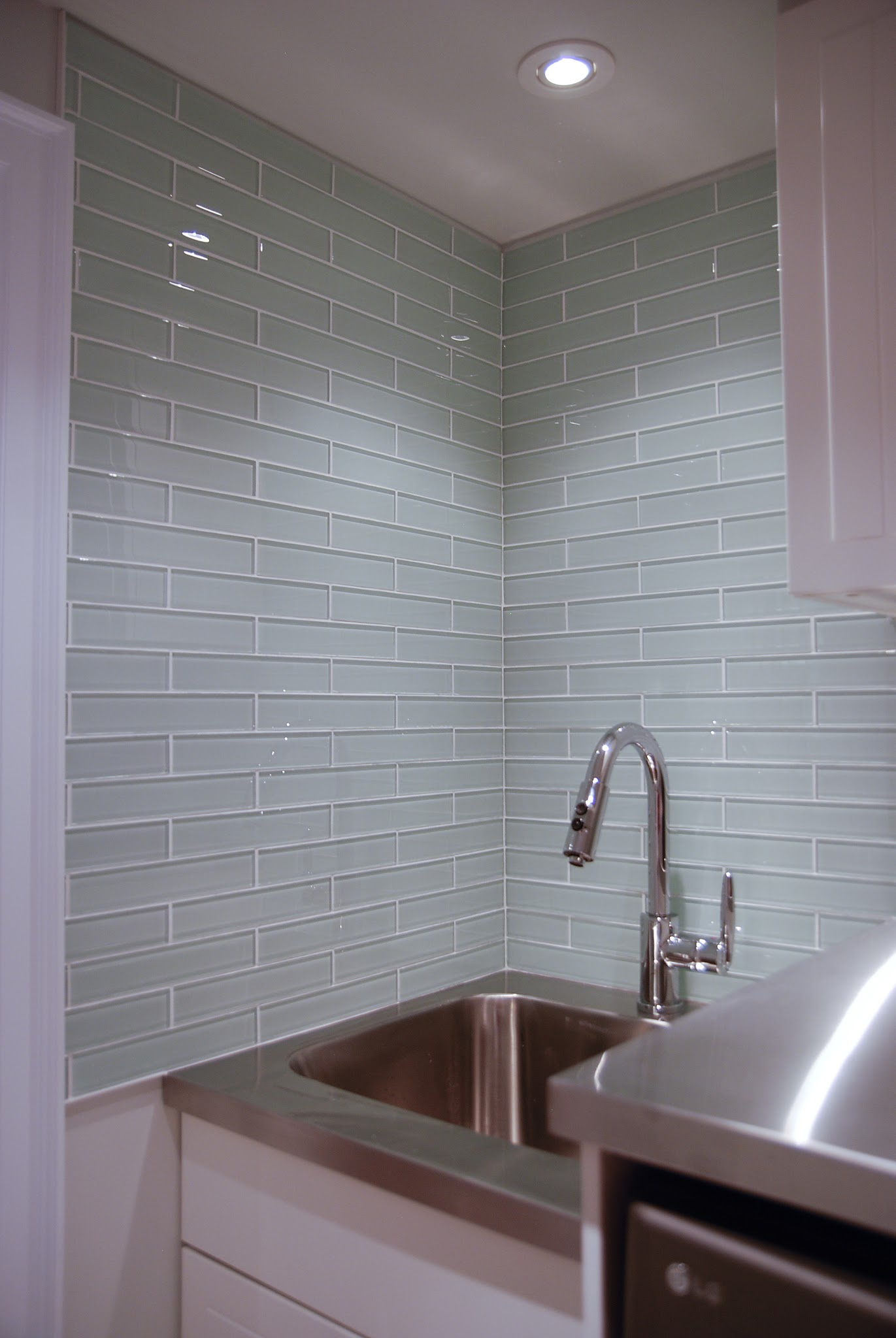 glass tile backsplash, glass tile in laundry room, laundry room backsplash, glass tile installation