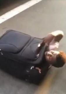 Zimbabwe man squeezes himself into suitcase