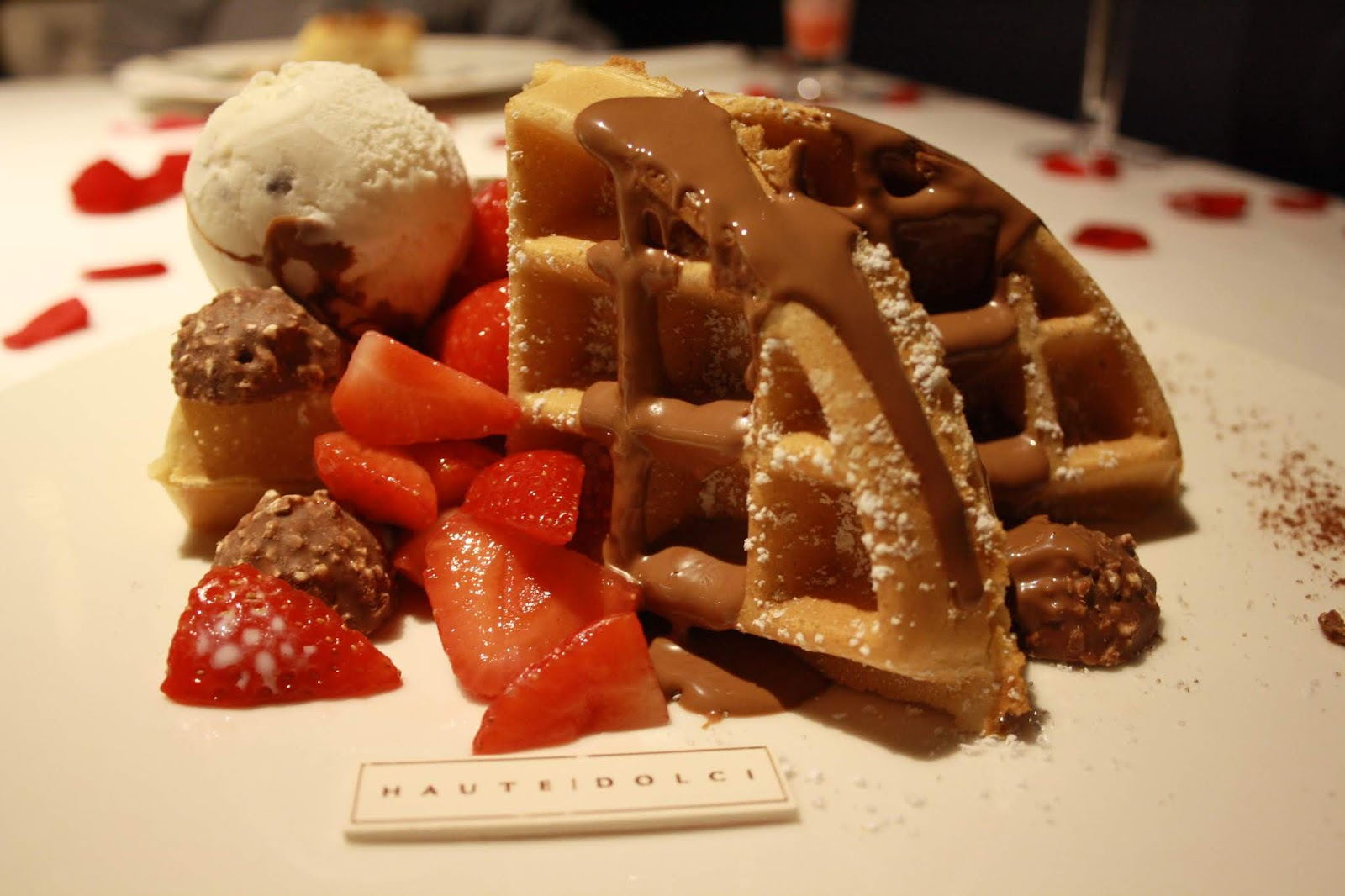American style waffle with chocolate sauce, Ferrero ocher, strawberries and ice cream