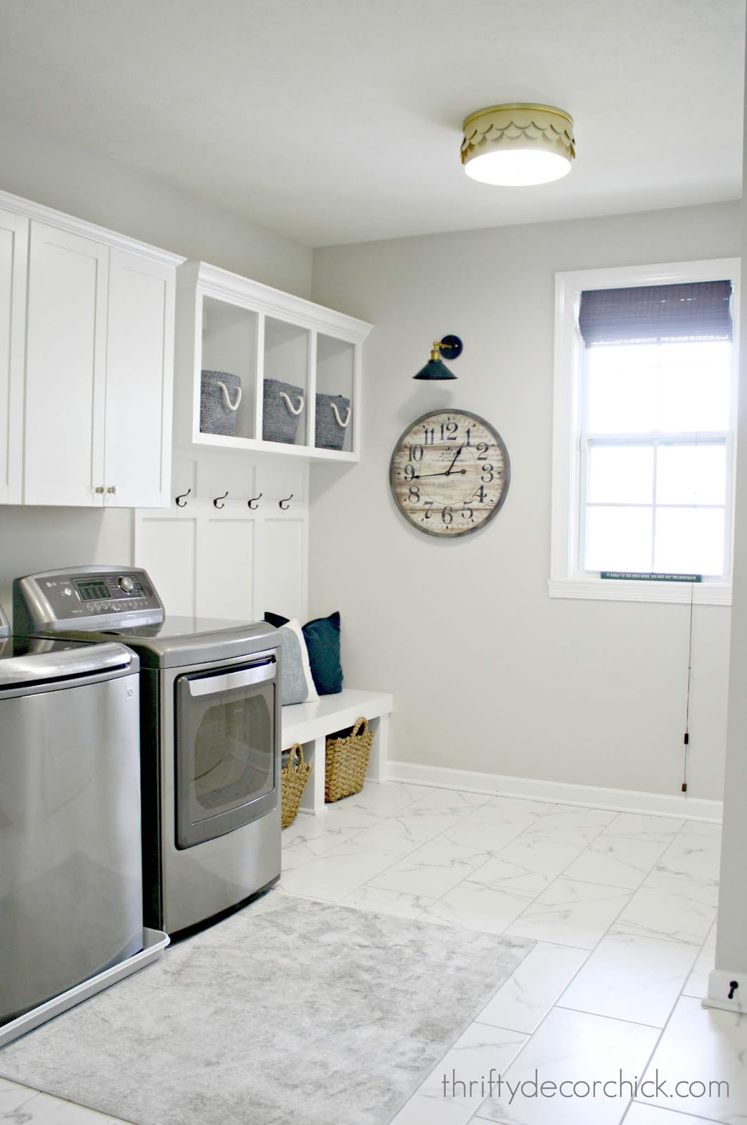 Laundry and mud room combination in white and gray