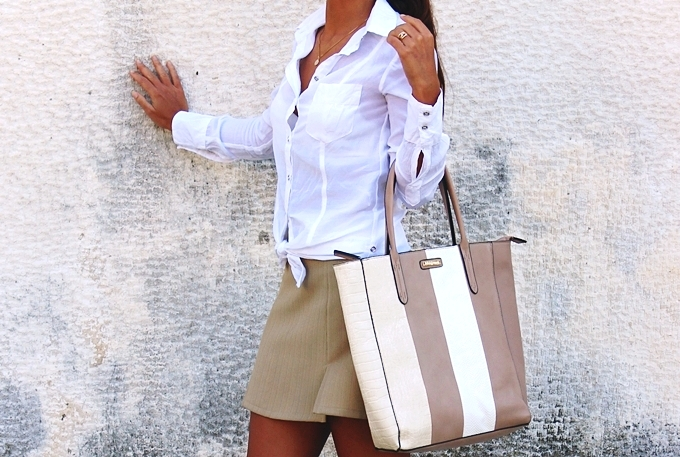 crisp woman white shirt and beige mini skirt