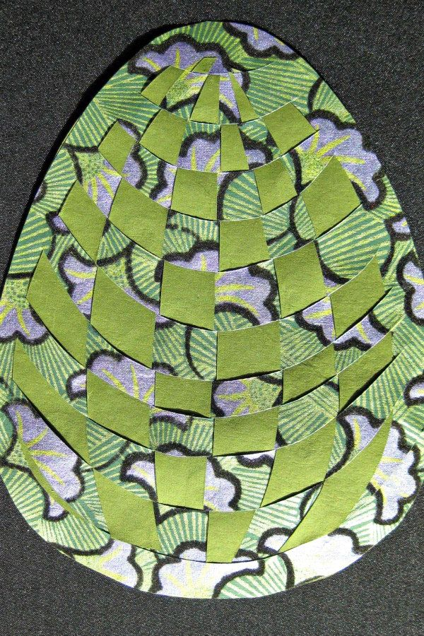 egg shaped paper weaving in shades of green, lavender, and black