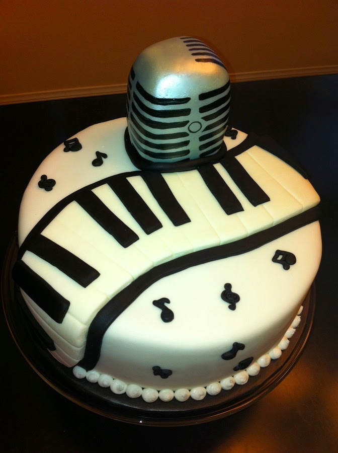 http://cakecentral.com/g/i/2198723/the-microphone-is-a-mini-carved-cake-i-airbrushed-it-with-silver-then-painted-on-the-black-the-music-notes-are-from-a-mold/