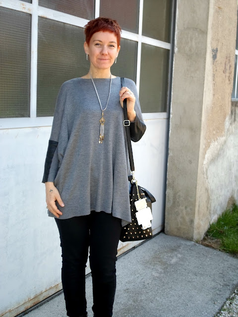 Oversized top, PU applications, studded black bag