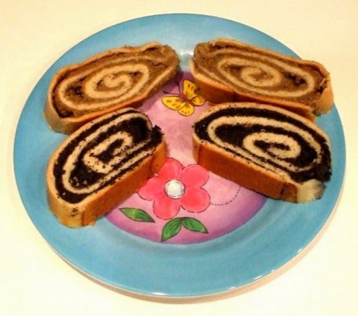 Hungarian poppy seed roll and nut roll on a pretty plate