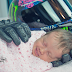 Dad passes away before baby's born. They take photo of baby being held by his motorcycle gloves