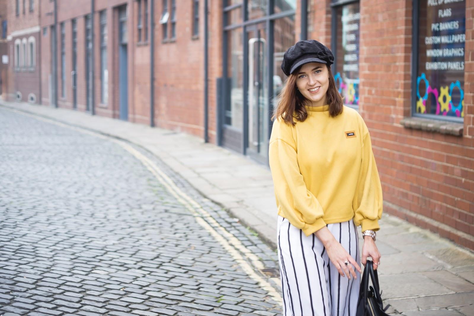 yellow jumper, smiling shot