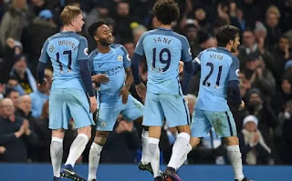 Manchester City fight back to see off Arsenal and go second