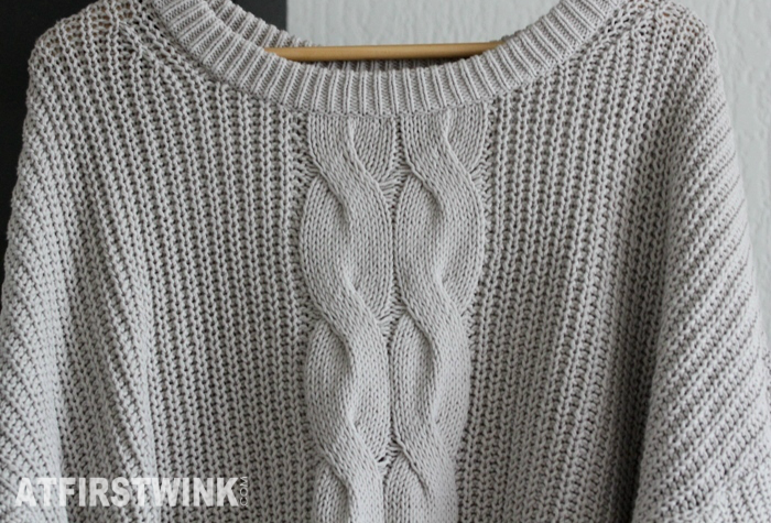 close-up H&M light grey knitted sweater bought at outlet store in Rotterdam