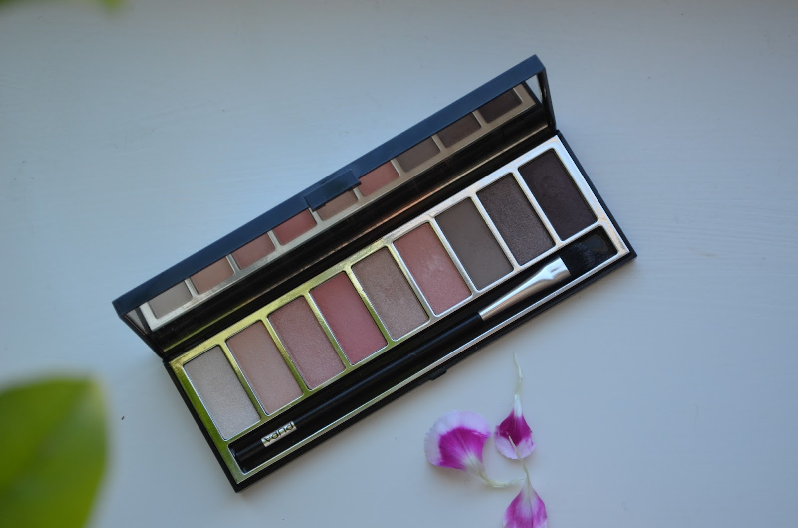 467281ba72d The packaging of the palette is very sleek and contains a brush, mirror and  9 beautiful eye shadows.