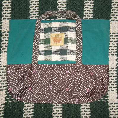 Handmade shopping bag with tablet woven handles in green and brown