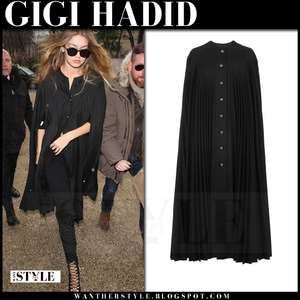Gigi Hadid in black burberry pleated cape and black lace up boots what she wore model style paris fashion week