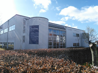 Viborg Library, a white building in the sunshine.