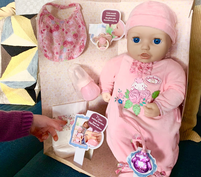Close up of the Baby Annabell doll and accessories in the packaging