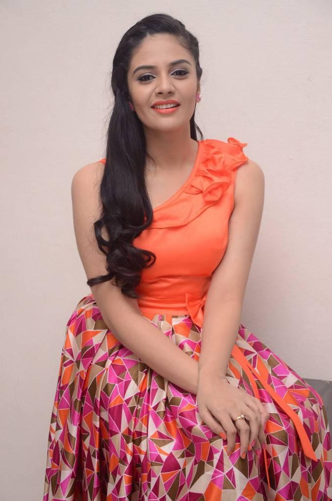 TV Anchor Srimukhi Smiling Face Stills In Orange Dress