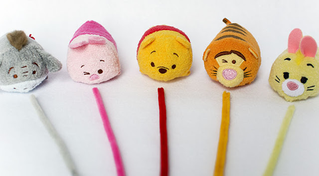 eeyore piglet winnie the pooh tigger and rabbit disney tsum tsum characters in a row with colorful pipe cleaners