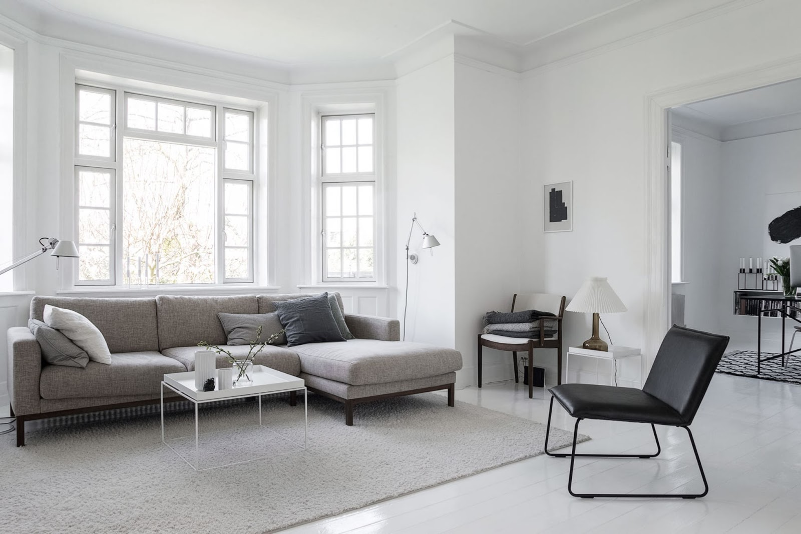 black and white interior design, nordic home, black furniture, white floor, monochrome decor