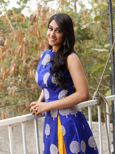 Regina Cassandra in Yellow Silk Lehenga with Contrast Blue Sleeveless Long Kurti At Shaurya Promotions