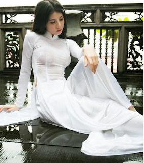 Hotgirl bella trần thai hoa facebook nóng bỏng với áo dài không nội y