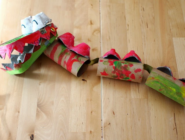 glue egg carton and toilet paper rolls together to make dragon