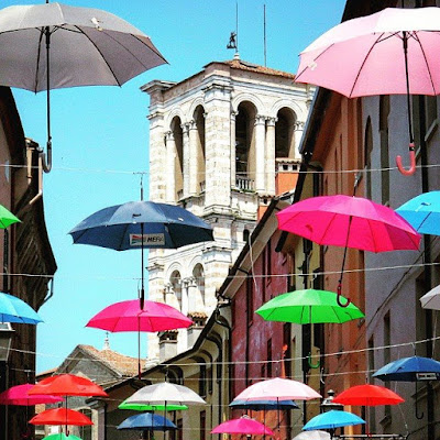 Things to do in Ferrara Italy. Seek shade under umbrellas