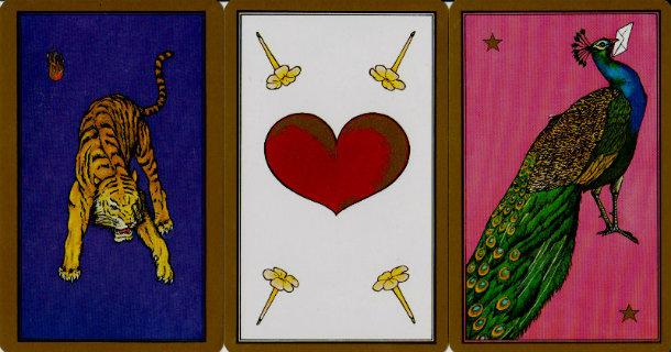 3 cartes alignées du tarot persan : un tigre, un coeur et un paon