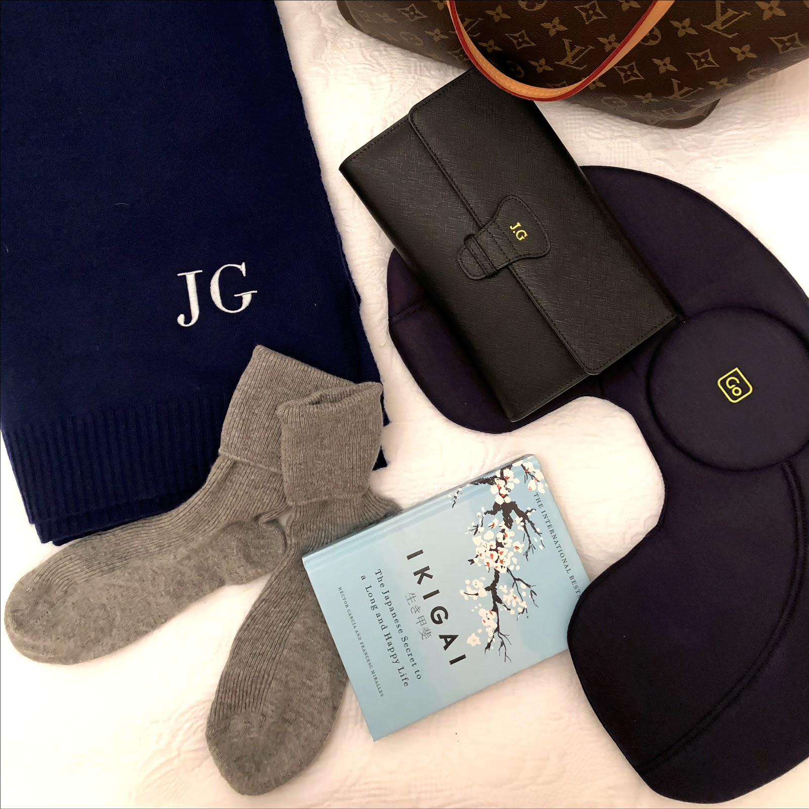 My Midlife Fashion, mimi and thomas cashmere large travel wrap, blacks cashmere ankle socks, louis vuitton never full, ikigai, go travel products travel pillow, lover of luxe travel document holder