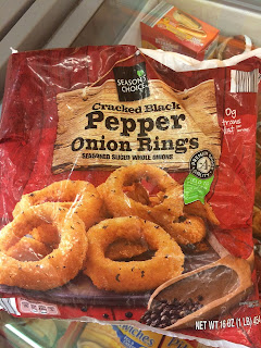 A bag of Season's Choice Cracked Black Pepper Onion Rings, from Aldi