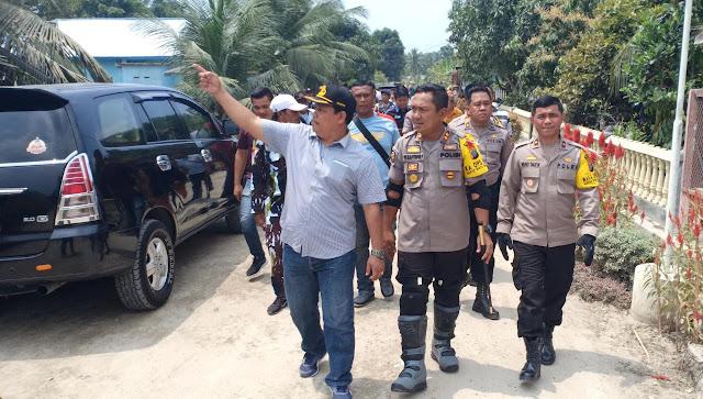 Kapolres Asahan AKBP Faisal Napitupulu bersama rombongan saat ke Desa Sipaku Area, Asahan.