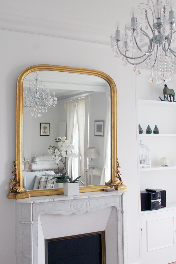 paris apartment fireplace and gold mirror