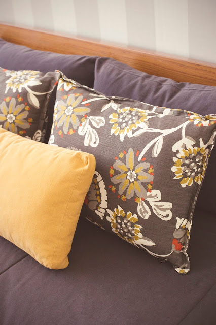 love the pillows and textured wallpaper from coordonné