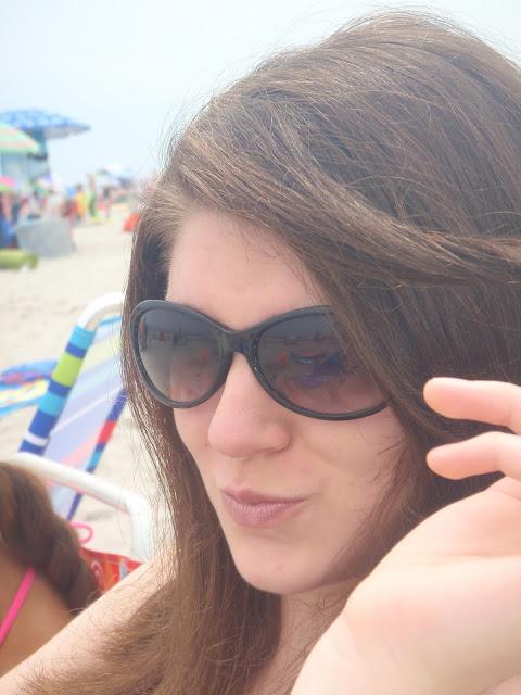 girl wearing sunglasses on the beach