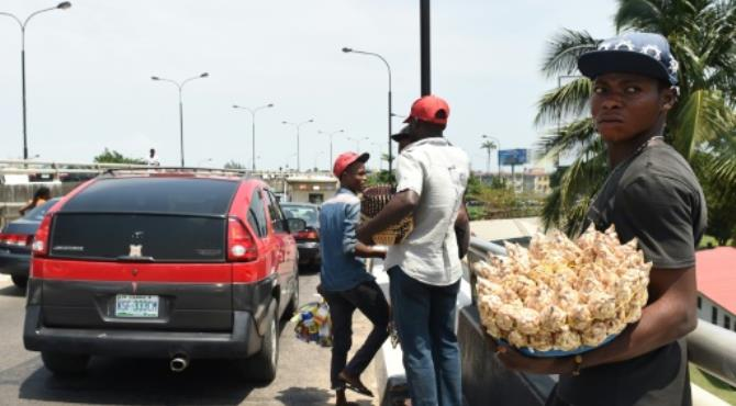 Street hawkers in Lagos now risk up to six months in jail and a fine if they are caught. By Pius Utomi Ekpei (AFP/File) Lagos (AFP) - Every morning, Mama Biliki prepares small bags of popcorn outside her ramshackle house in Ajegunle, one of Lagos' poorest neighbourhoods, to sell by the roadside for 50 naira each. (CDWR)