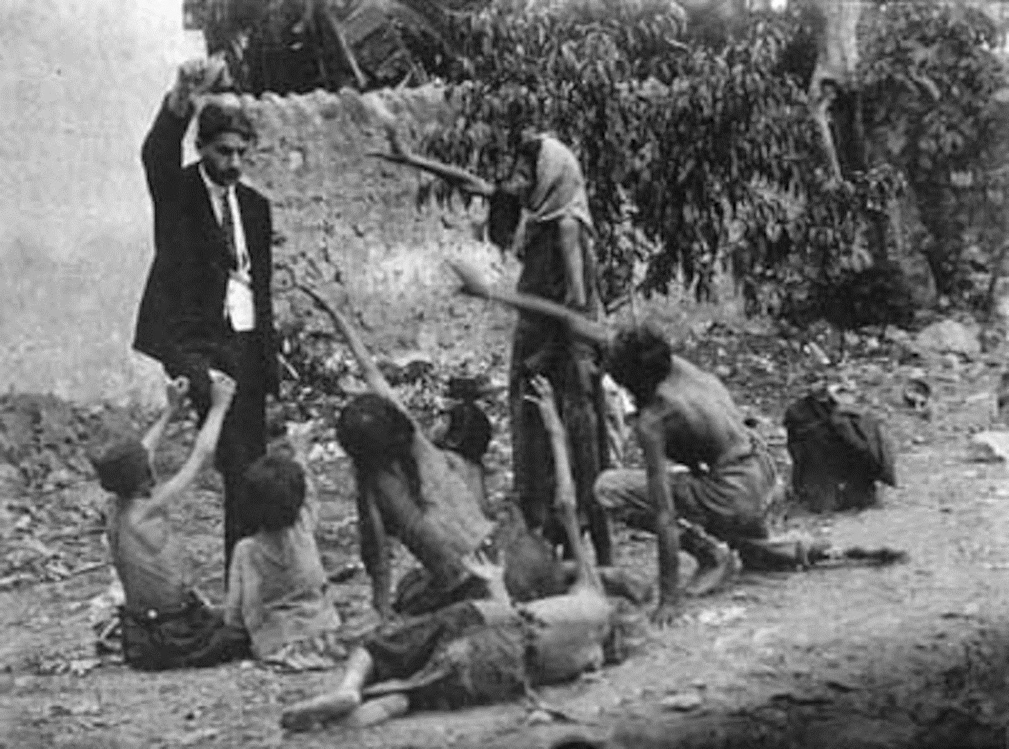 Turk official teasing Armenian starved children by showing bread 1915 Collection of St. Lazar Mkhitarian Congregation - The Recognition of the genocides as the beginning of justice against the crimes against humanity
