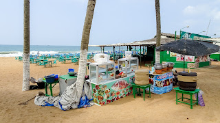 Many Africans sell food on the beach in Lome.