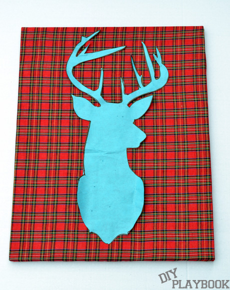 Stencil your reindeer silhouette directly onto the fabric canvas.