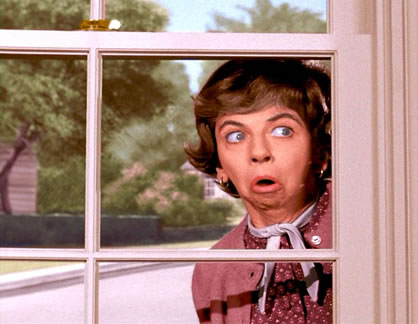 Mrs. Kravitz nosy neighbor watching Samantha and Darren.