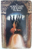 The book cover features the ghostly image a St. Winifred in the foreground with Brother Cadfael under an arch behind her and a line of five monks in the background.