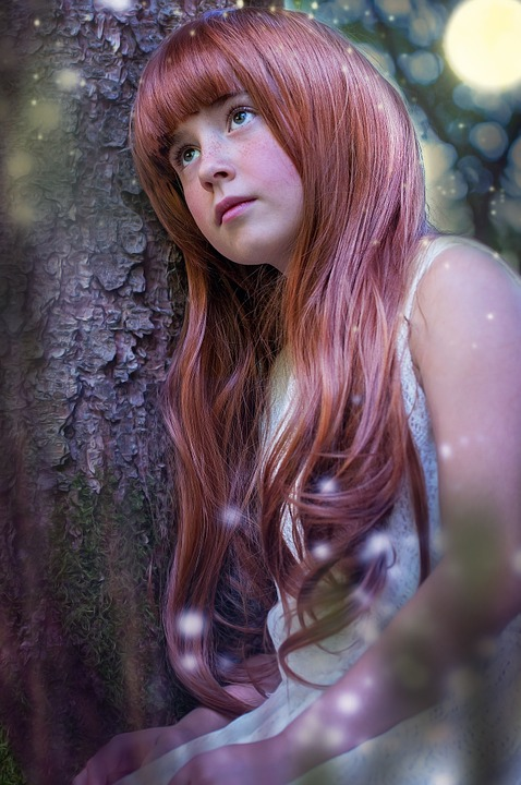 Red-haired girl with long, shiny hair