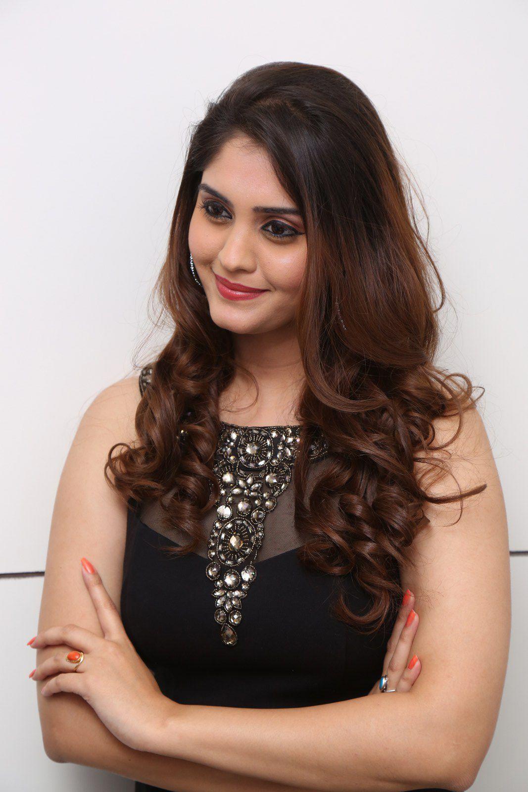 Surabhi Hot Legs Show Stills In Black Dress