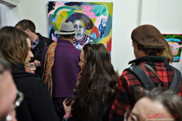 Art crowd; Harlequin Animalia by Anna Wheeler at Janet Clayton Gallery. Photo by Kent Johnson.