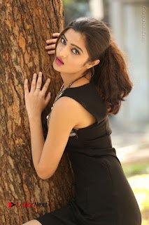 Actress Poojitha Pallavi Naidu Stills in Black Short Dress at Inkenti Nuvve Cheppu Movie Platinum Disc Function  0046.JPG