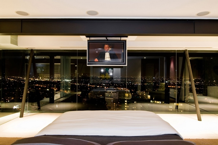 Glass wall and tv from the bed in Hollywood Mansion by Whipple Russell Architects