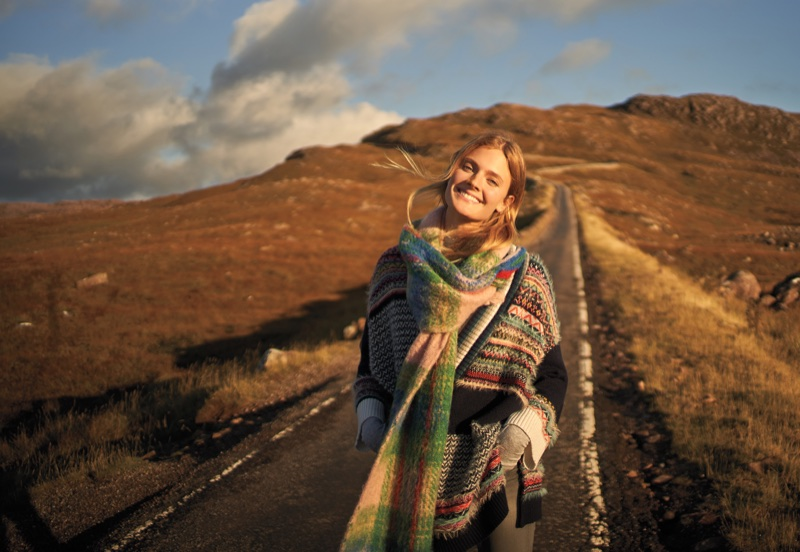 Constance Jablonski layers up in knit scarf and striped sweater for Anthropologie's November 2017 catalog