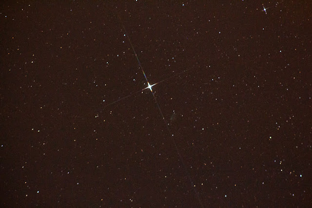 Capella with diffraction spikes from STAR-4 filter.  DSLR, 170mm, 8 seconds (Source: Palmia Observatory)