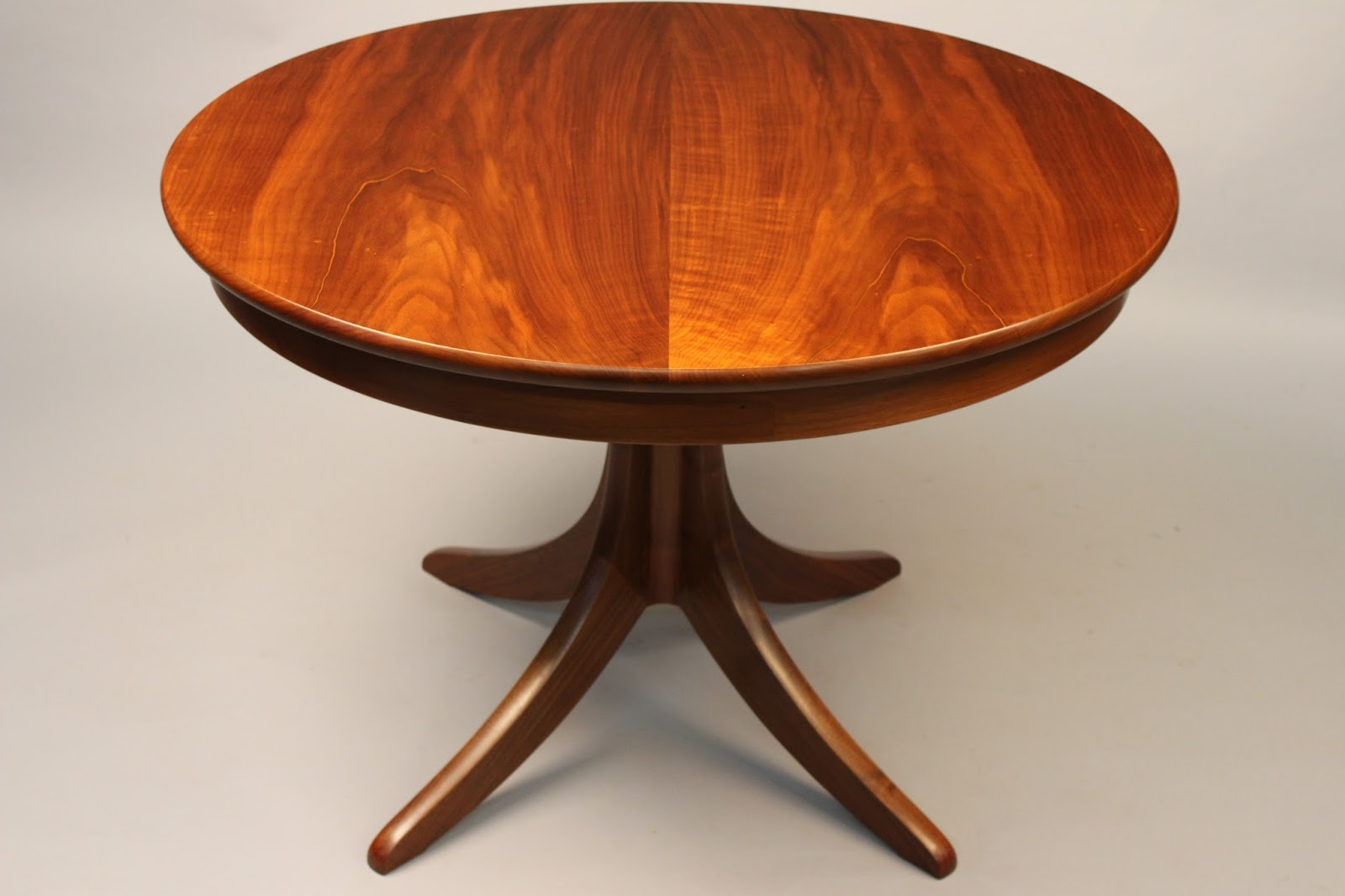 Pedestal table handcrafted of walnut