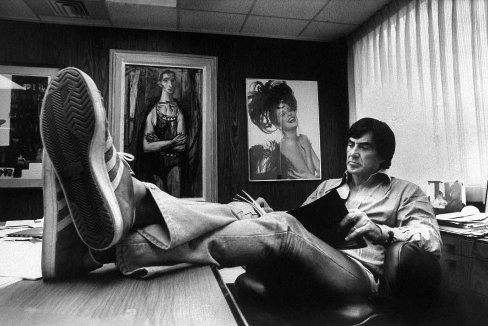 John DeLorean reading in his home office. 1974.